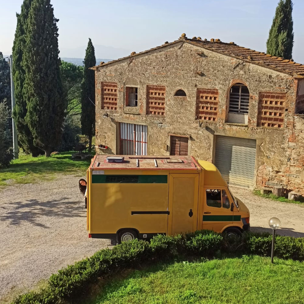 Yellow Van parked in tuscany