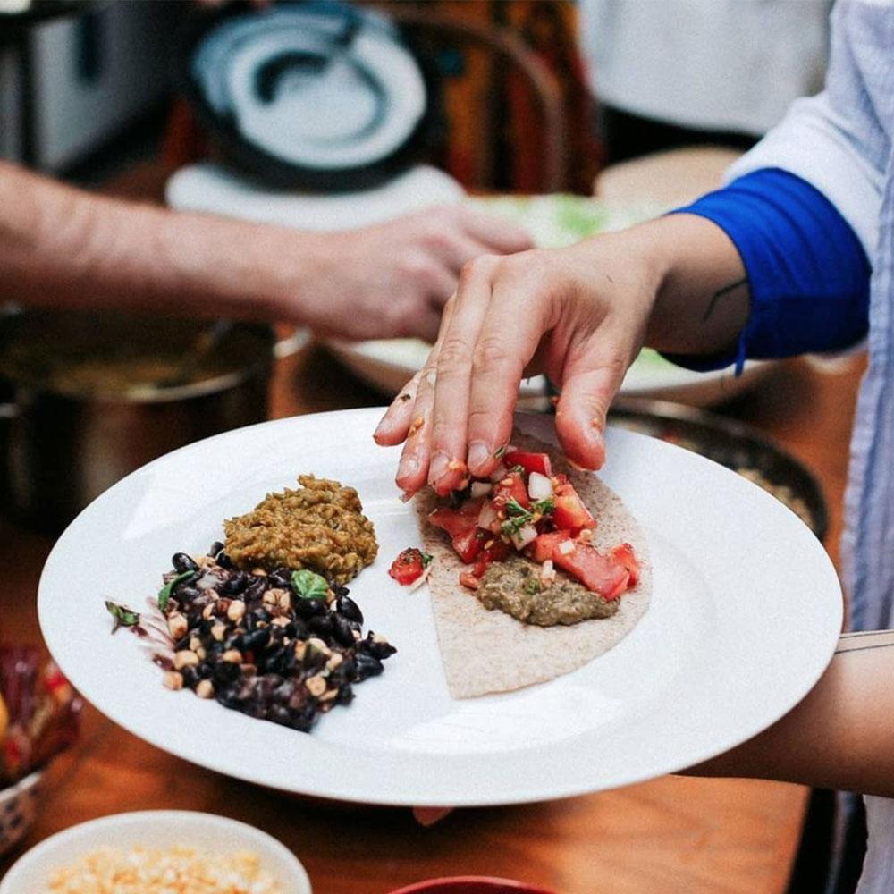 Hand making a taco