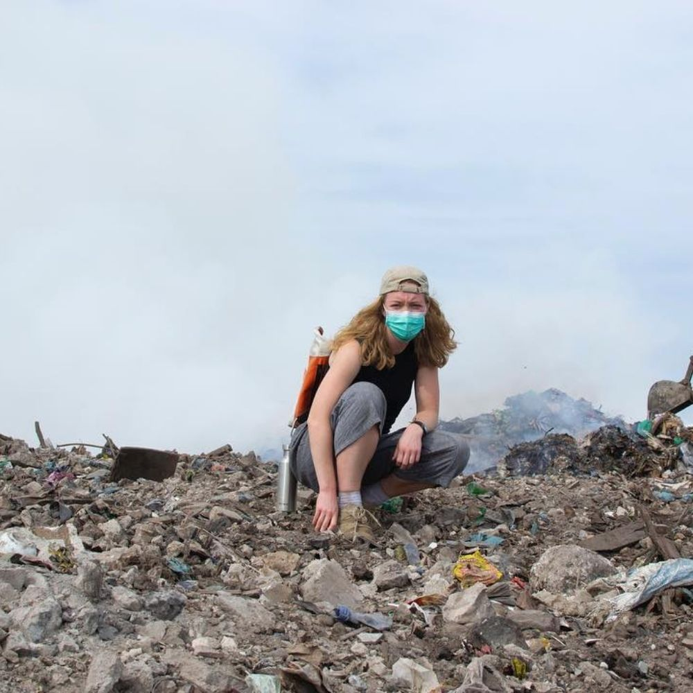 Woman standing on landfill