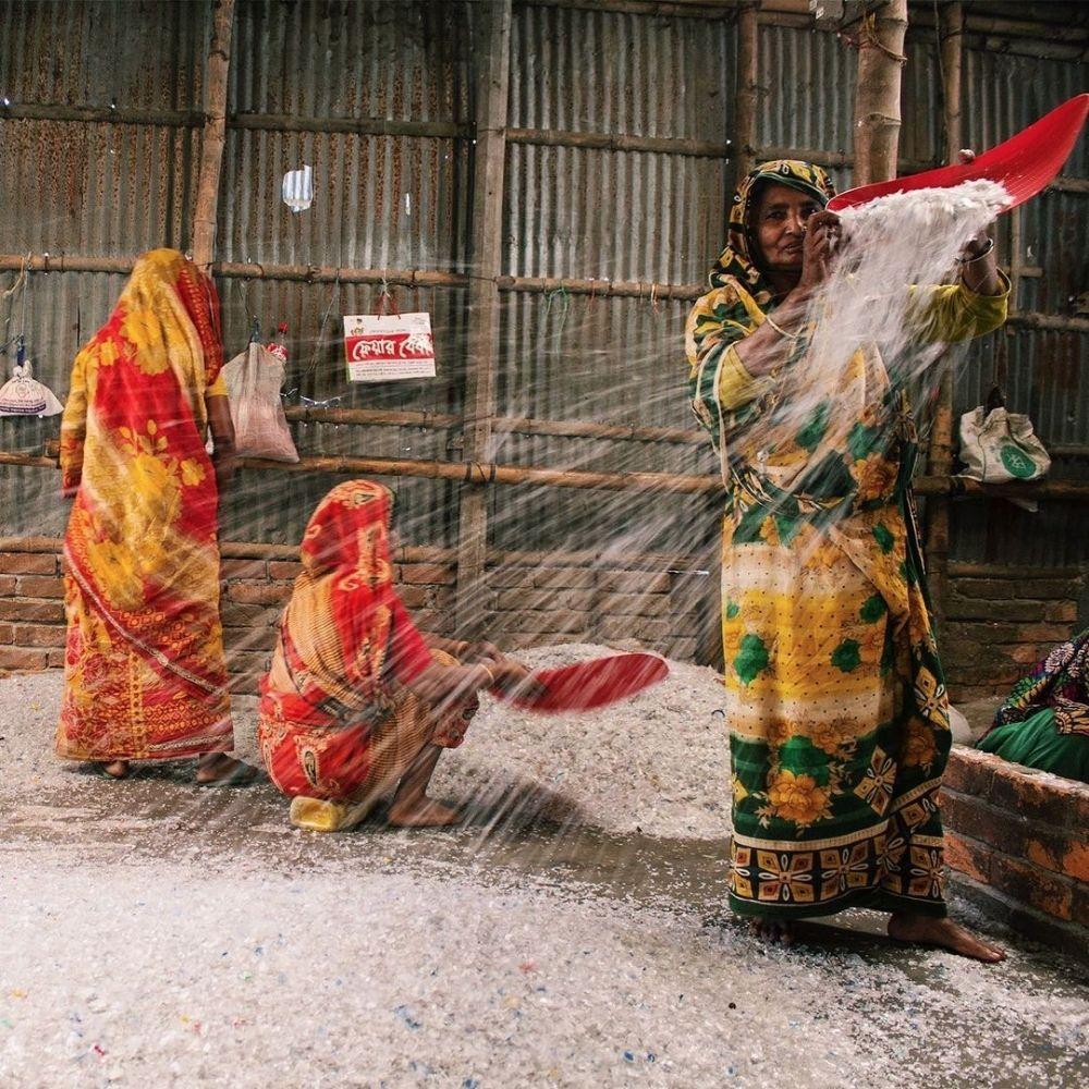 Woman drying shredded plastic