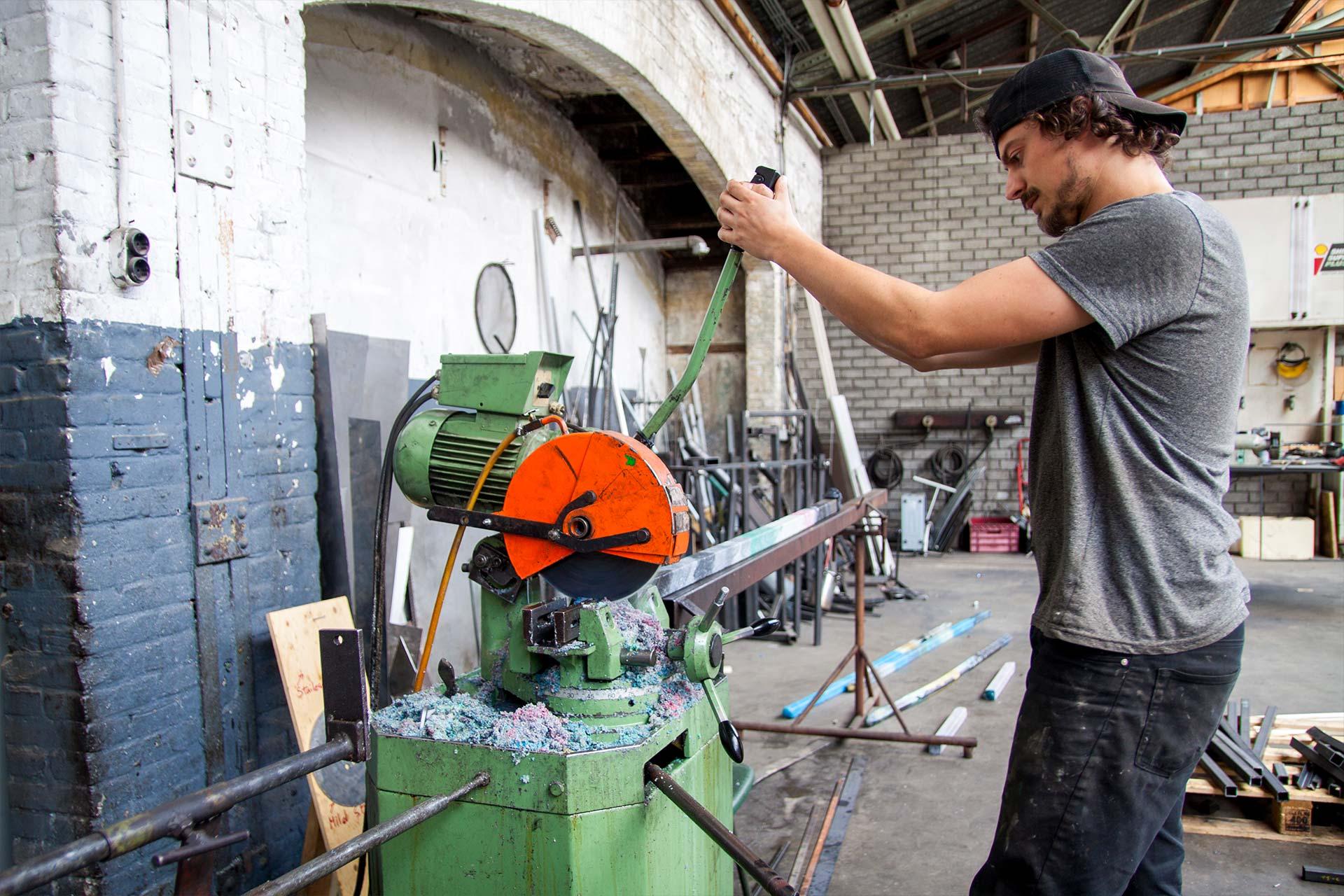 man cutting a plastic beam