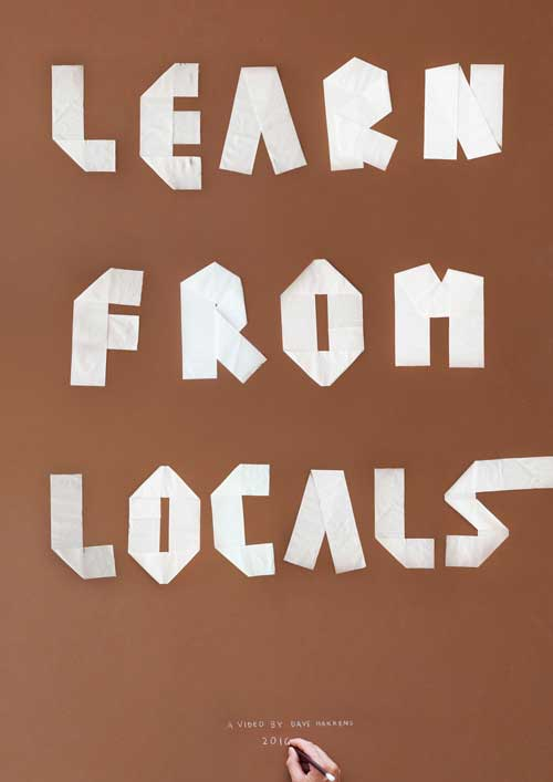 "Poster made using toiletter paper saying ""learn from locals"""