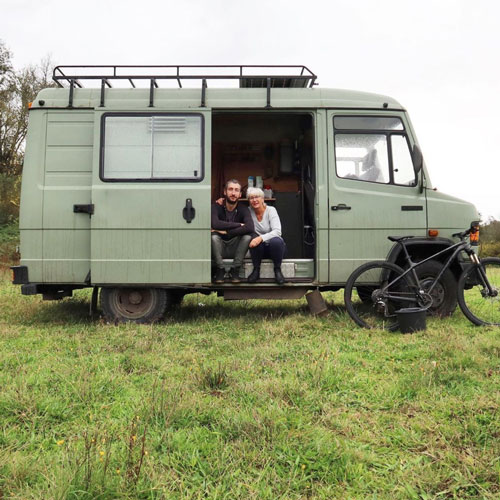 Green ex german army mercedes ambulance 609D converted to a camper parked on a land