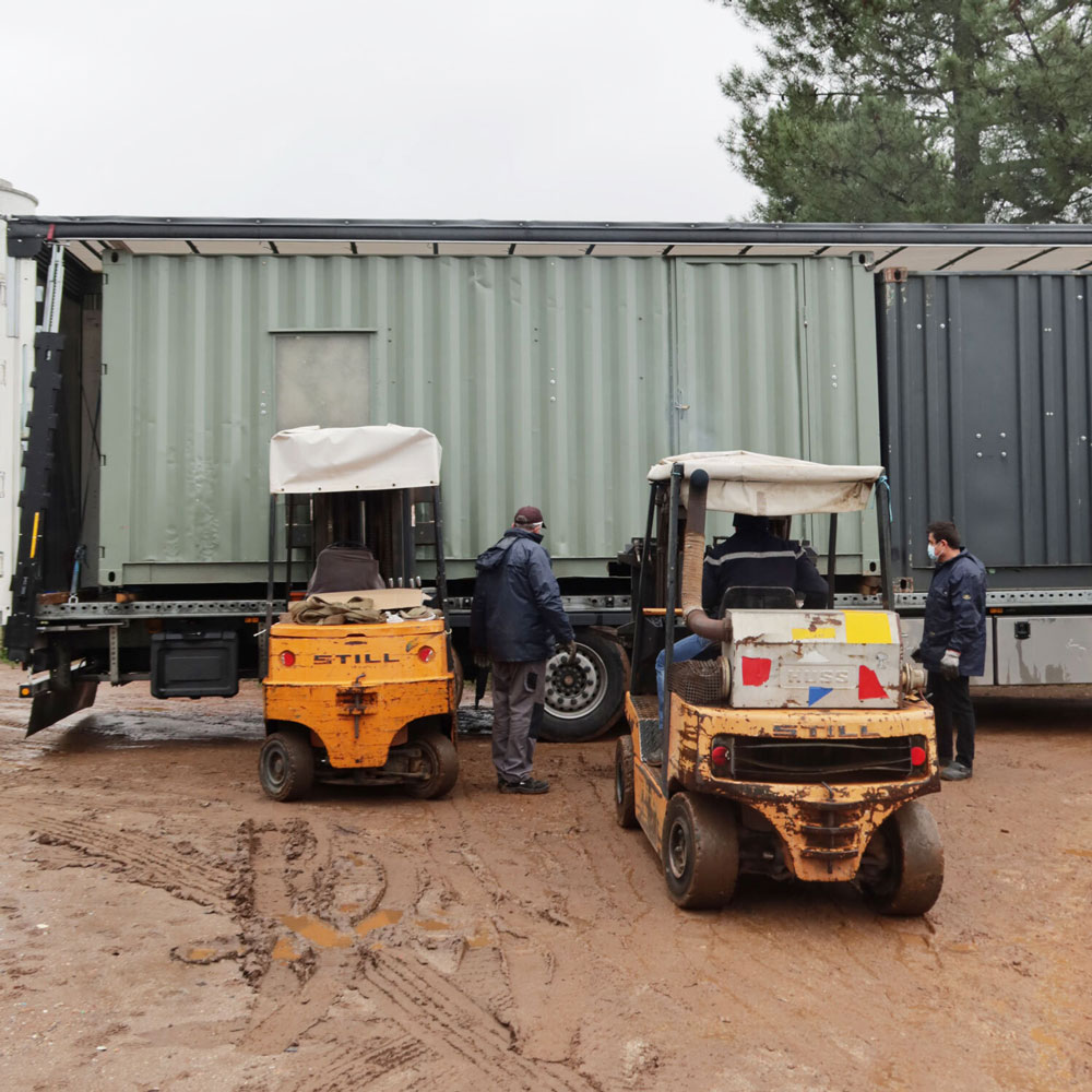 Containers on a truck with a forklift