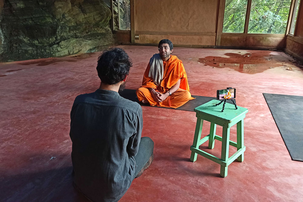 man interviewing a Krishna monk