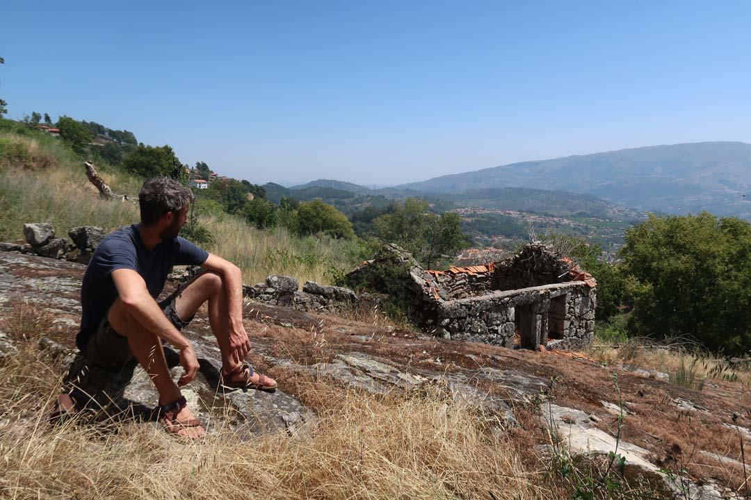 Man looking at a ruin