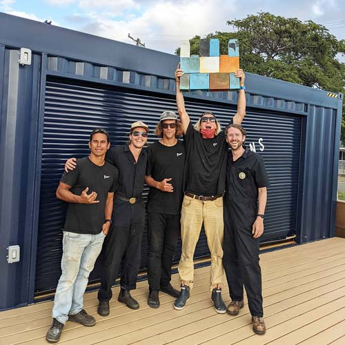 4 men with recycled bricks