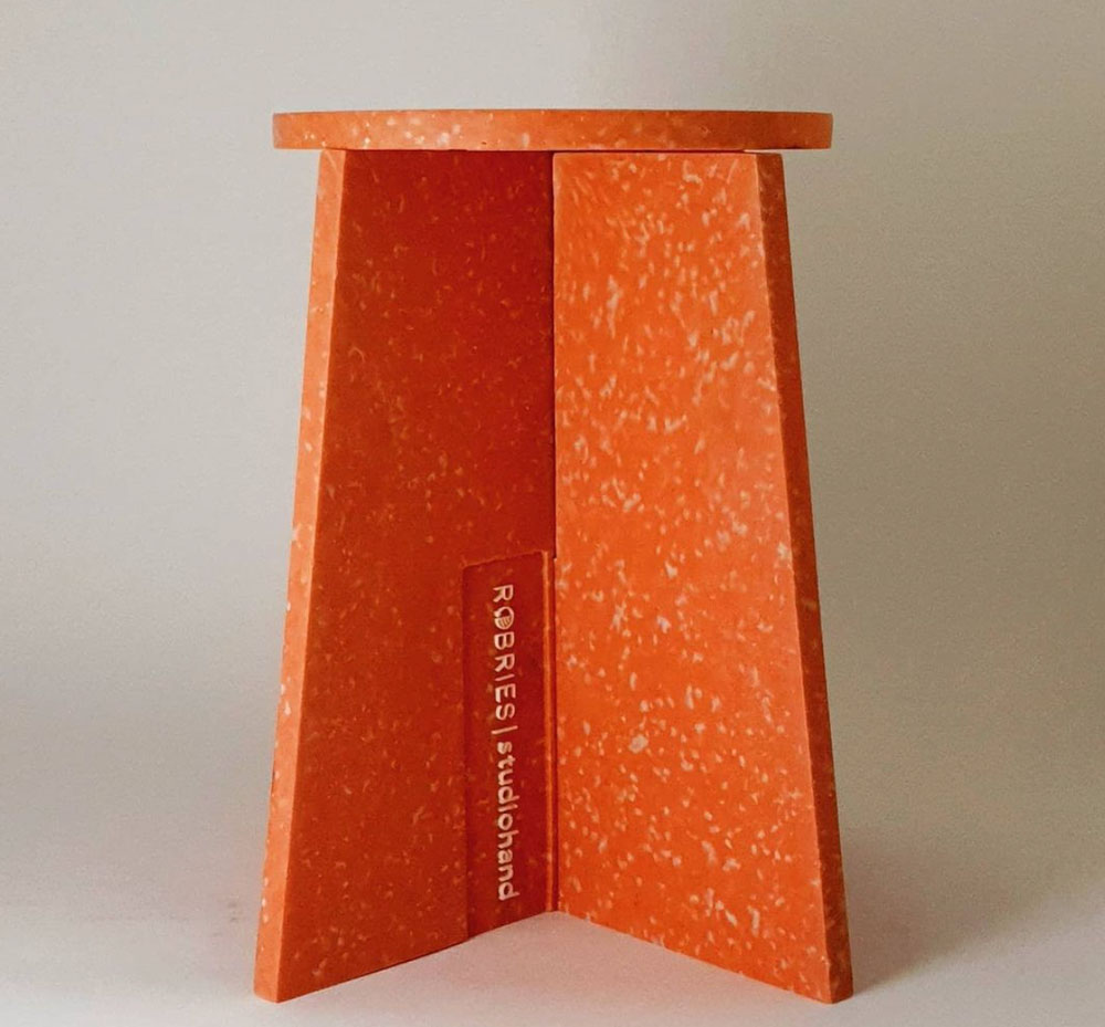 Orange stool from recycled plastic