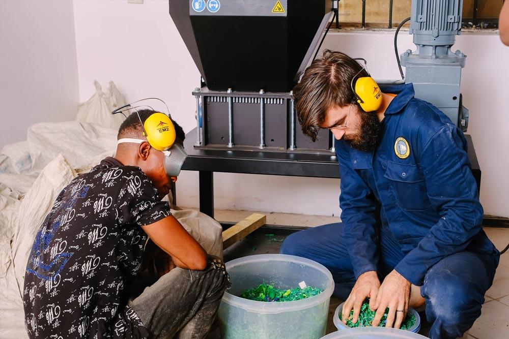 2 men sorting plastic
