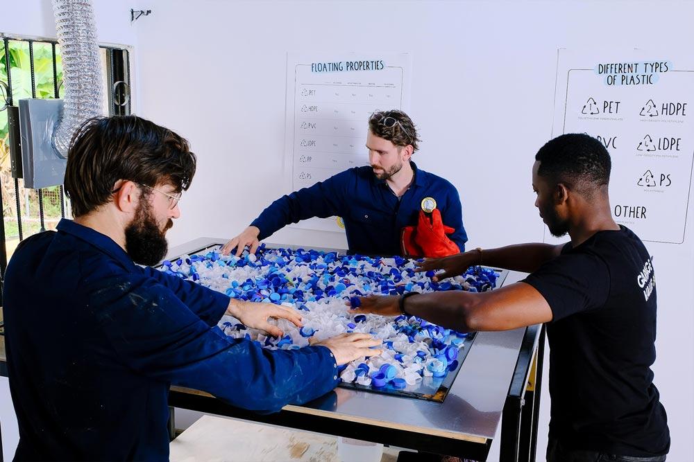 men recycling plastic into a sheet
