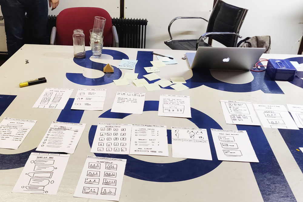 Community Platform wireframes on a table