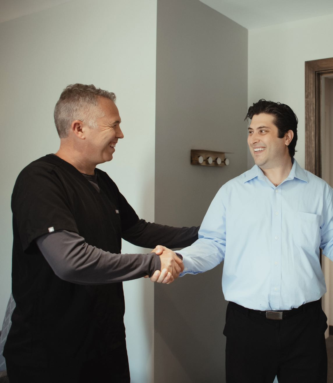 Photo of Dr. Brent Van Hala shaking hands with a patient