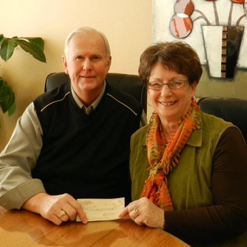 The Christensen family with donation check