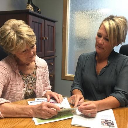 ladies reading documents