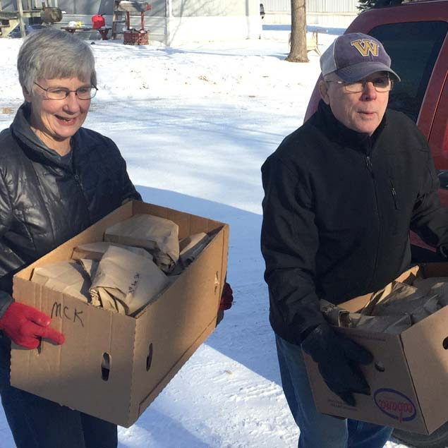 Volunteers delivering boxes of sandwiches