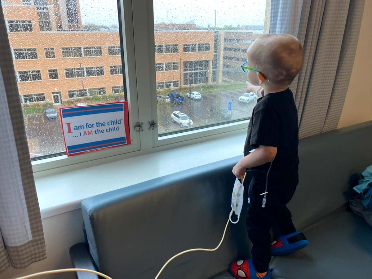 child looking out window at childrens hospital