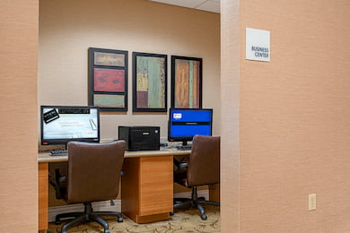 Business Center - two computers with chairs