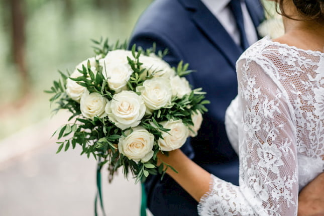 Couple with a Wedding Bouquet