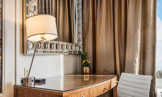 Northside Queen Bedroom - Desk with lamp and mirror