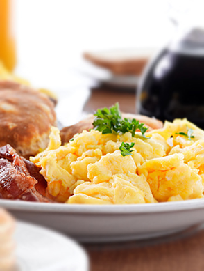 Complimentary Breakfast - Scrambled Eggs, bacon, biscuits, and more!