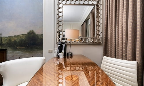 Southside King Bedroom - Desk with two chairs and a mirror in the wall.
