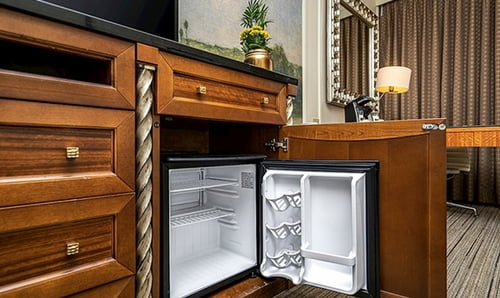 Southside King Bedroom - Mini fridge open under the tv furniture.