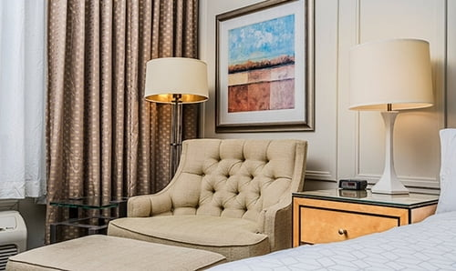 Northside King Bedroom - Sofa with lamps, night table and a beautiful painting