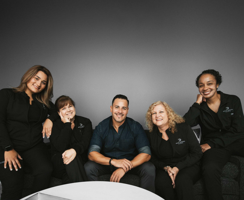 Photo of Dr. Will O. Deliz DMD and the Deliz Dental Studio team