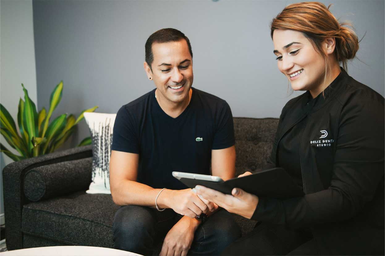 Photo of a team member and a patient looking at an iPad