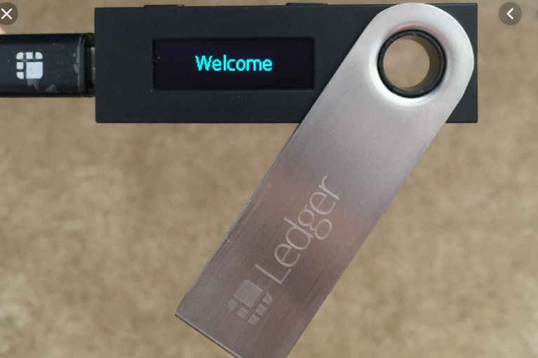 A Ledger hardware cryptocurrency wallet opened is displaying a welcome message.