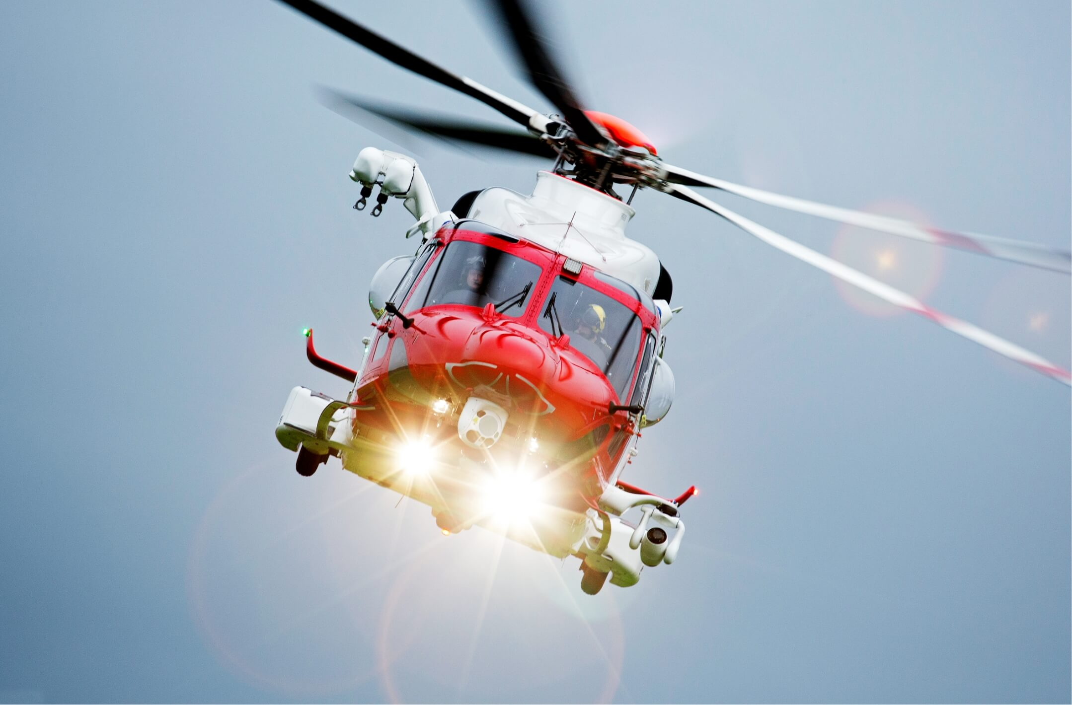 Lobo Leasing red Helicopter flying with head lights
