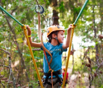 Boy on ropes course.