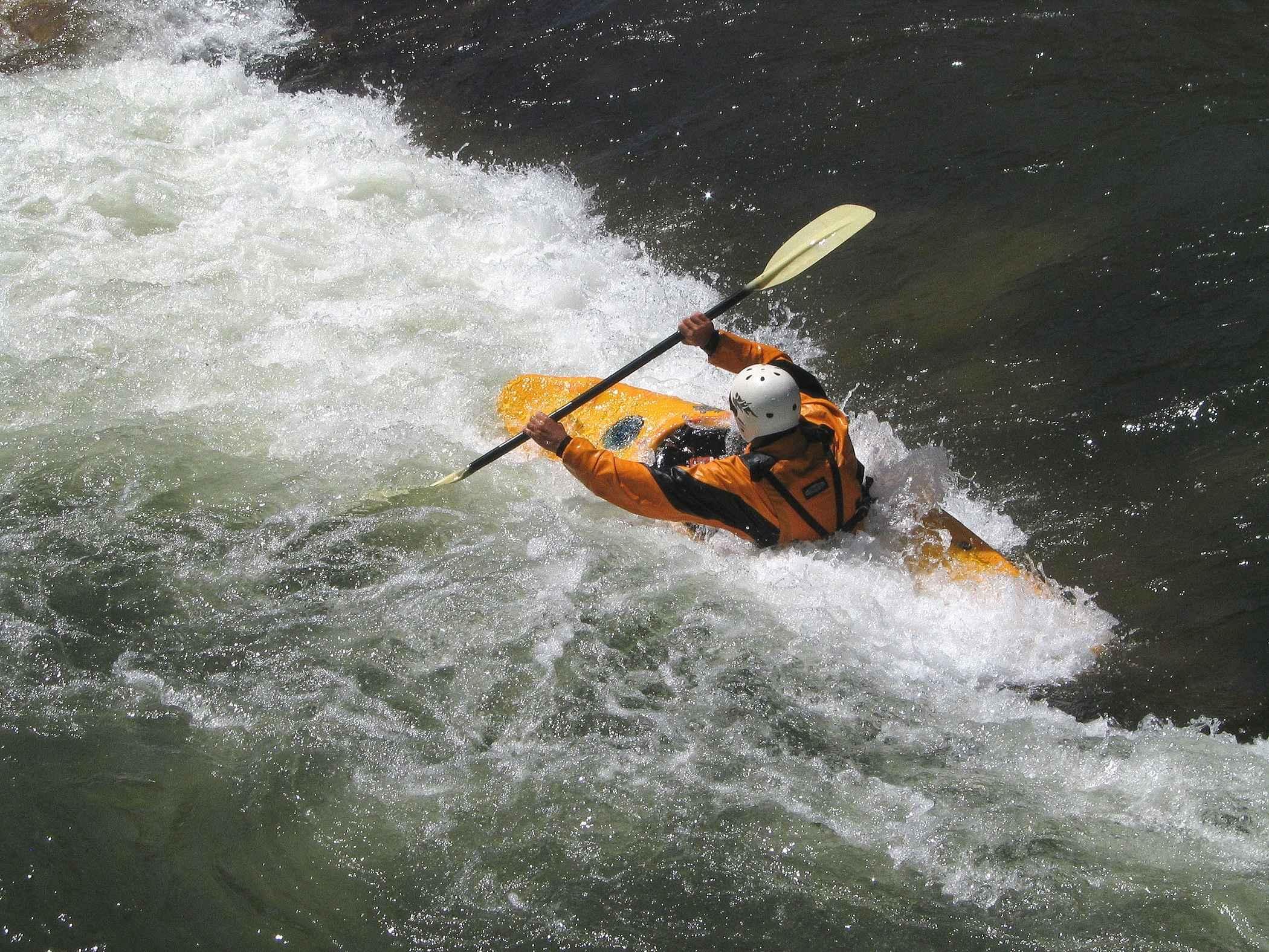 Man in orange kayak.
