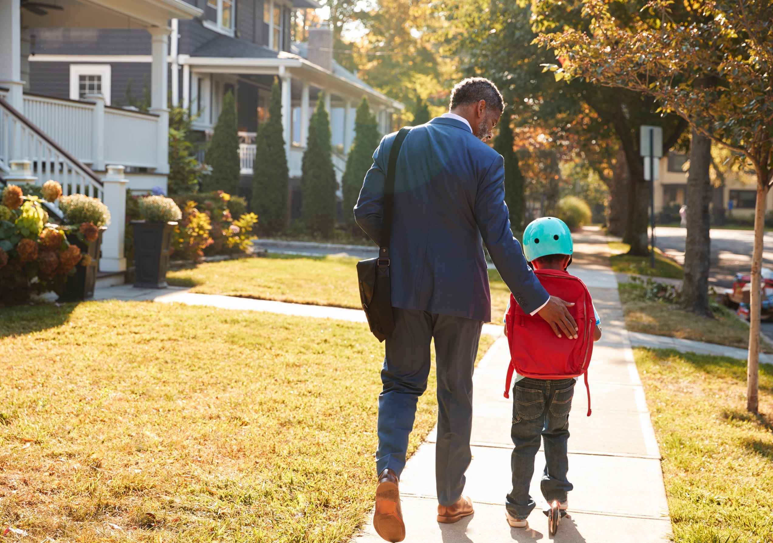 Business man walking with son.