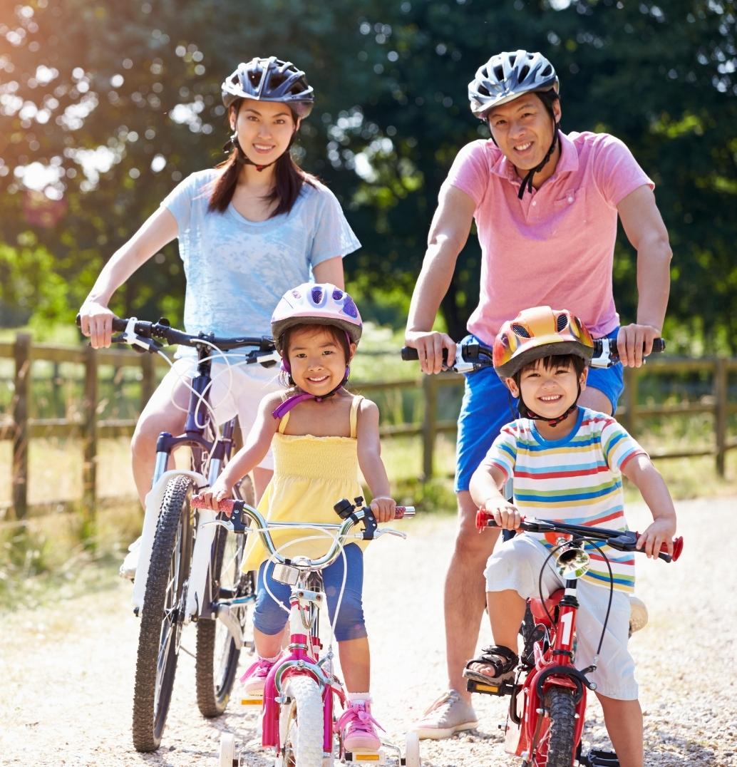 Asian family riding bikes.