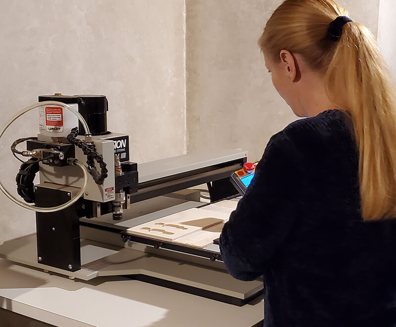 Laurie Knight working with rotary engraver