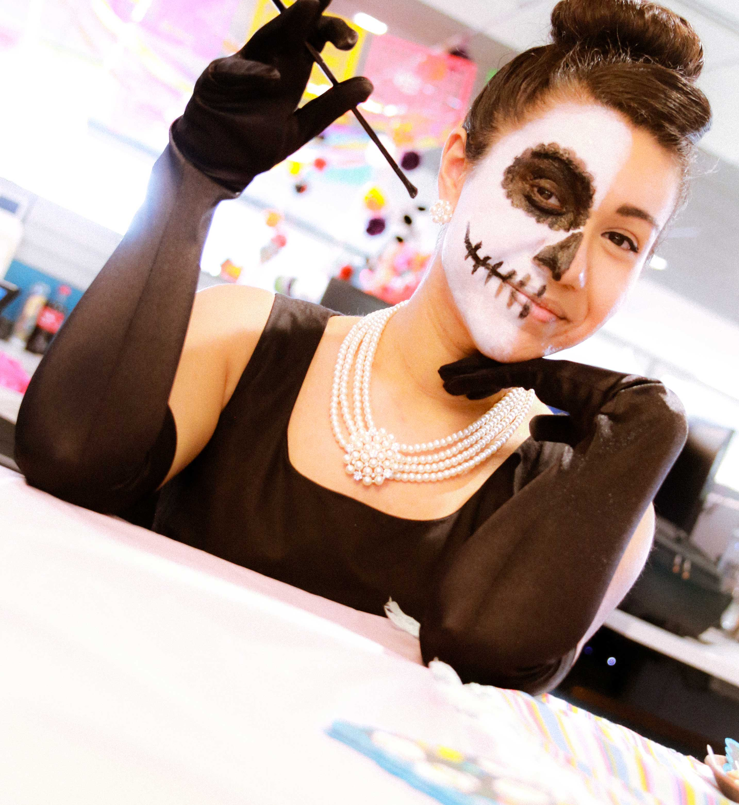 A woman dressed in Day of the Dead make up