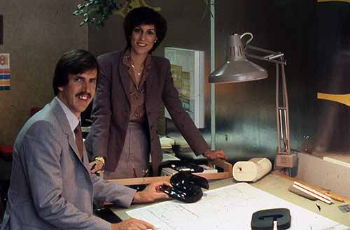 A vintage photo of a man and a woman at a desk