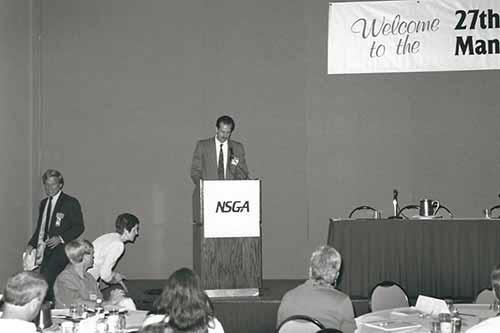 A man behind a podium giving a speech