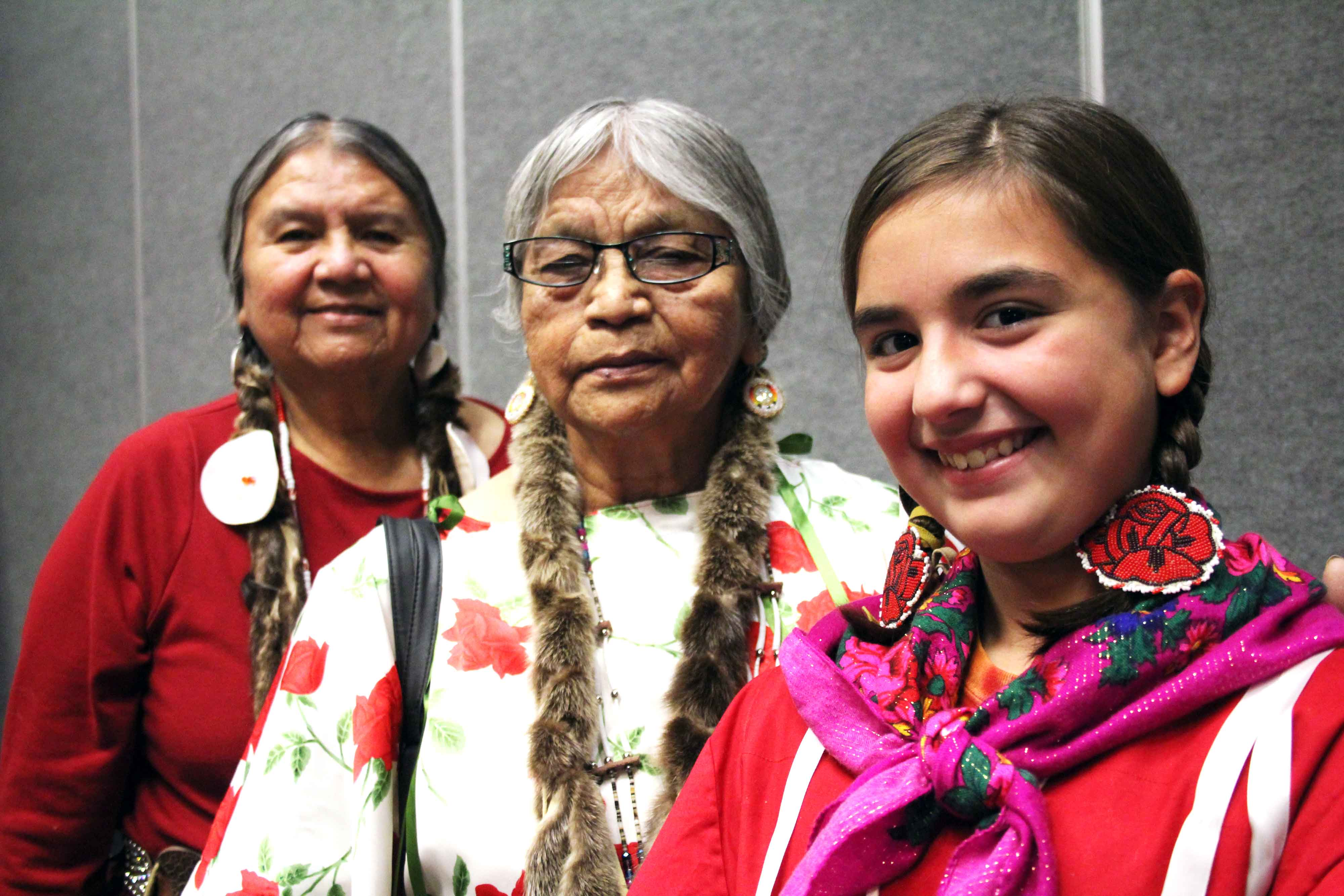 Two older and one younger women from the Yakima Nation.