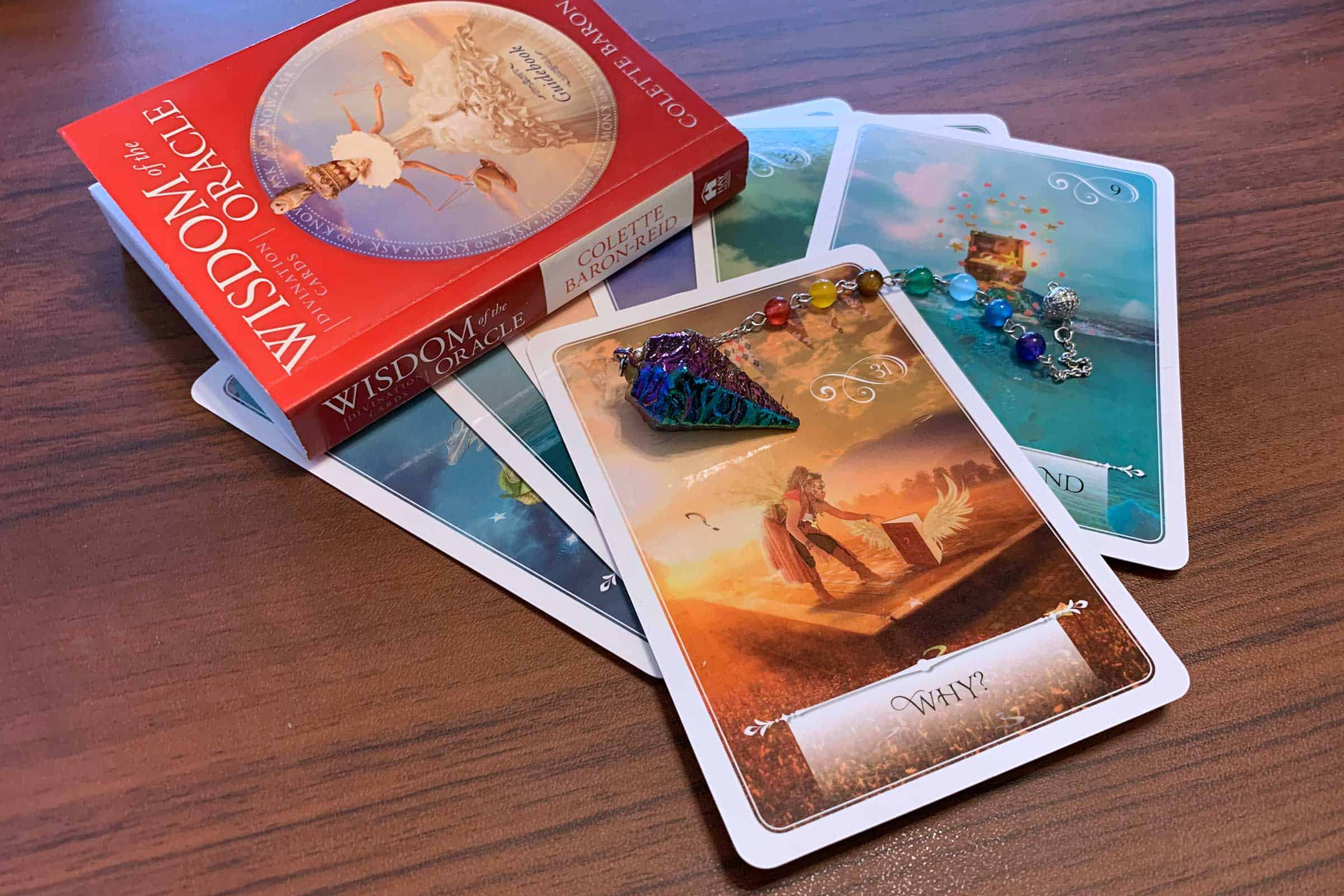 How your why impacts your coaching business brand. (Shown: Wisdom of the Oracle deck by Colette Baron-Reid)