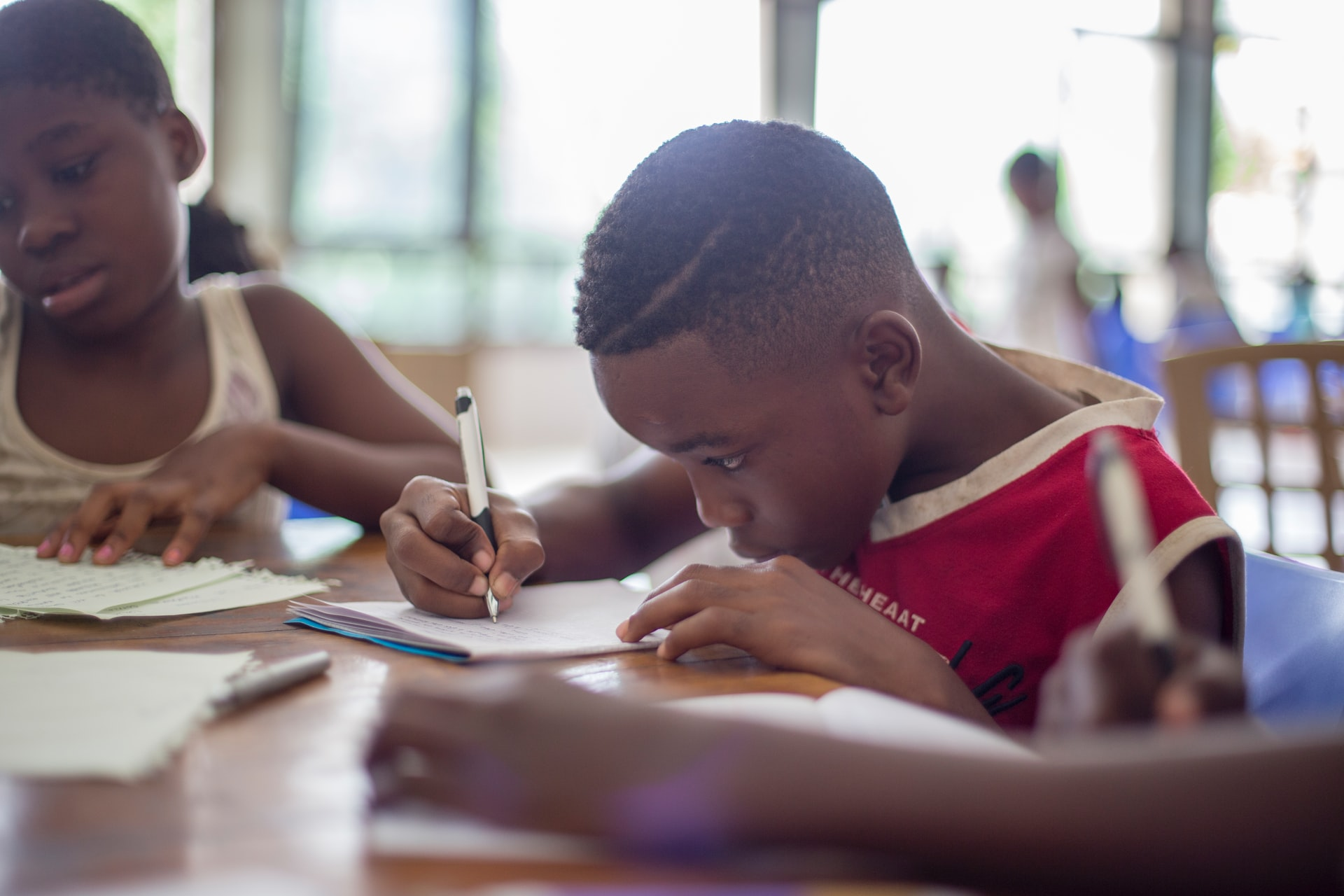 A picture of a young boy completing work at school