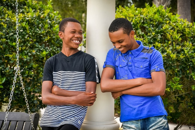 A picture of two teenage boys smiling and laughing