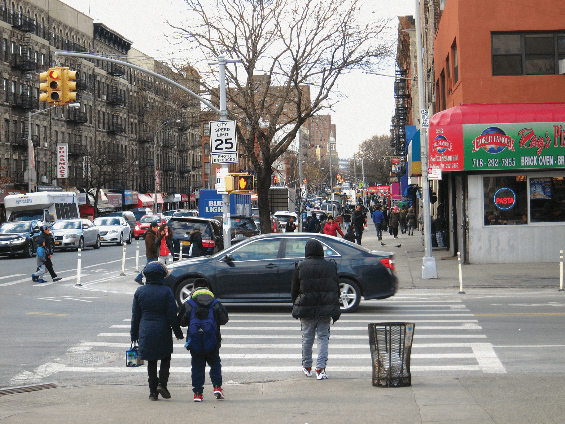 139th Street in the Bronx, A mother and child are crossing at an intersection