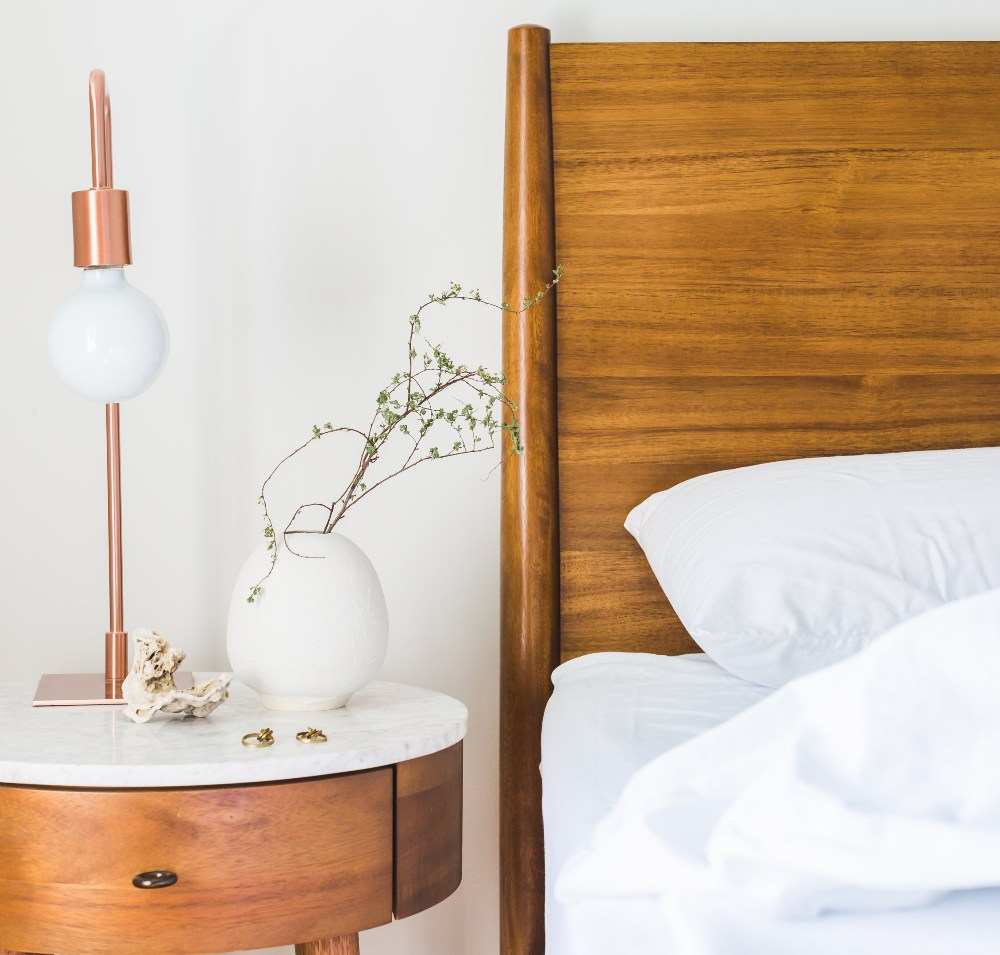 a nightstand and bed