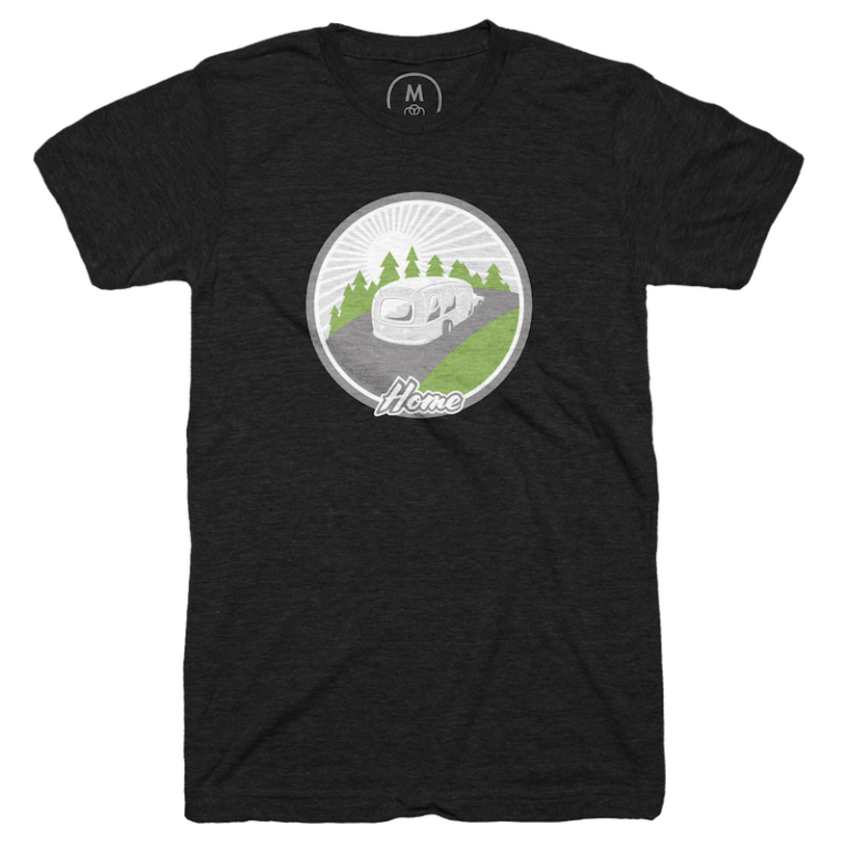 A black t-shirt with an illustration of a camper driving down the road.