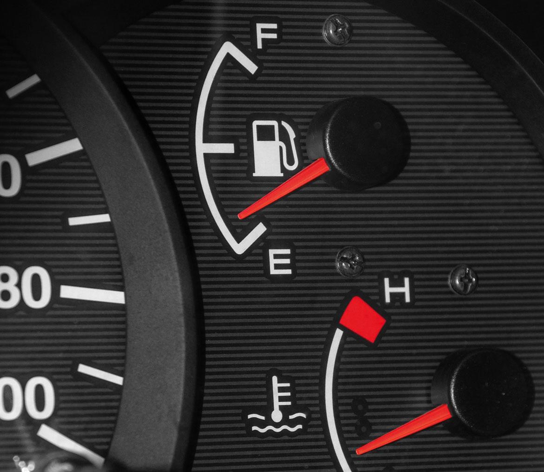 A car dashboard showing empty fuel