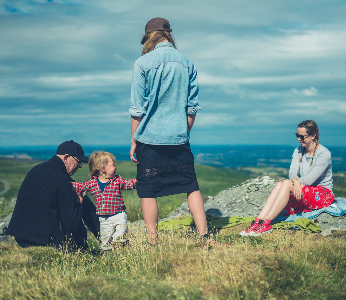 A family group on top of a hill
