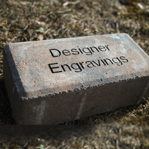Gray brick with 'Designer Engravings' engraved into one side