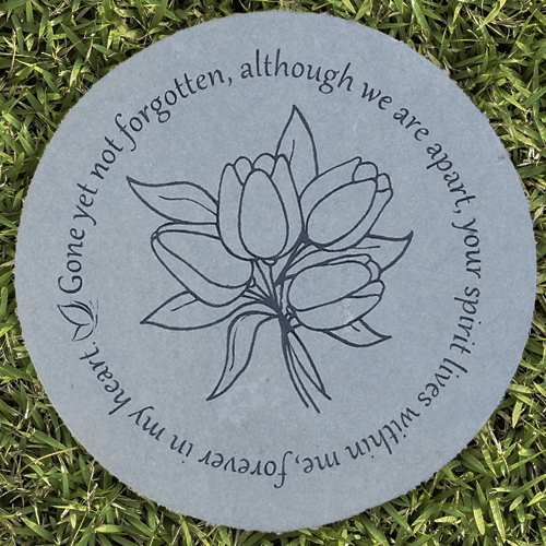 Round blue stone with tulips engraved in center. Wording around 'Gone yet not forgotten, although we are apart, your spirit lives within me, forever in my heart.'